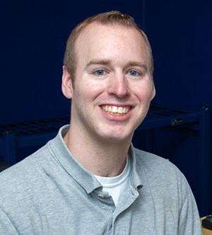 Professional headshot of a young blonde male wearing a polo shirt. This is Adam Montville, the Chief Technology Officer of Borealis Digital Marketing