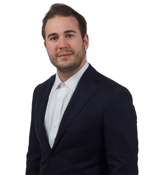 Professional headshot of a young brunette male wearing a suit. This is Kevin Kohlert, the President of Borealis Digital Marketing