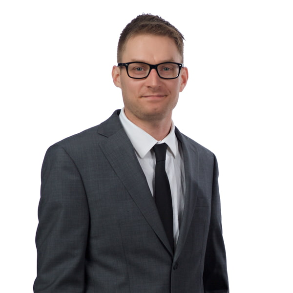 Professional headshot of a young blonde male wearing a suit. This is Michael Daugherty, a Content & SEO Specialist at Borealis Digital Marketing